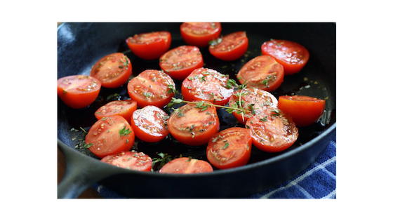 sauted tomatoes on cast iron skillet
